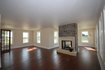 hardwood floor pictures - living room with middle fireplace